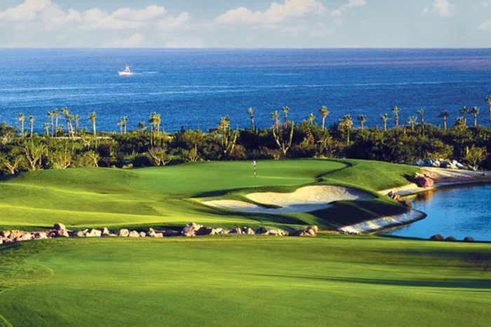 Beautiful green golf course with the ocean in the background