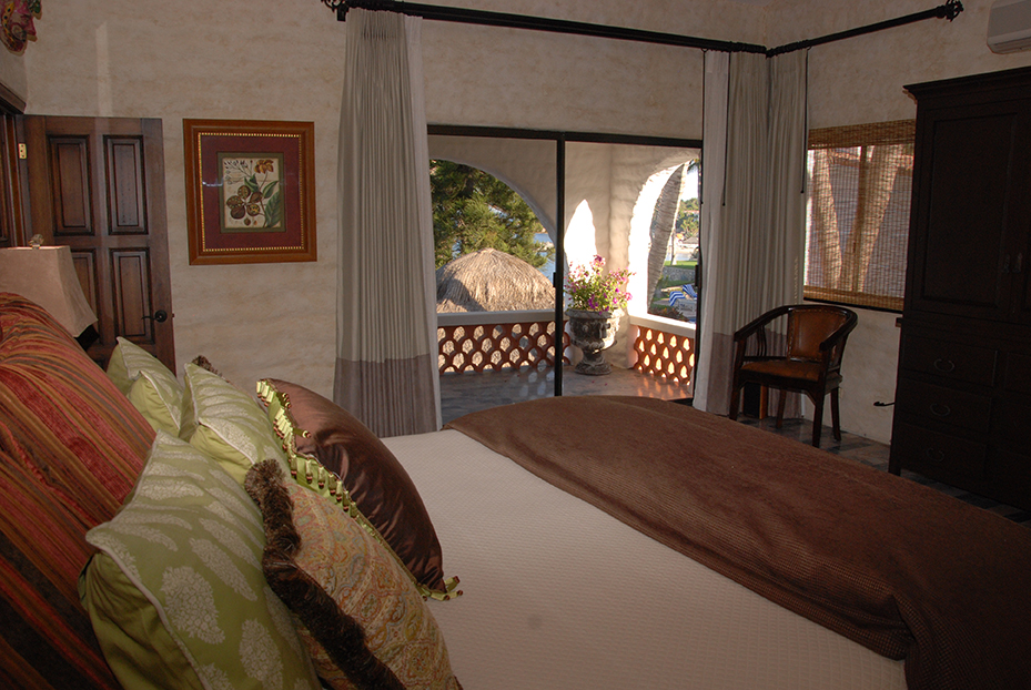 Bedroom view with large comfortor and bed