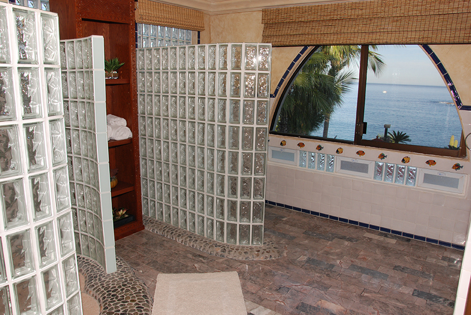Bathroom overlooking the beach with large glass shower partitions