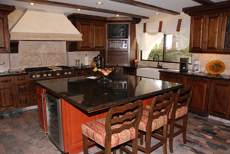 kitchen interior with marble countertops and craftsmen style wood cabinets