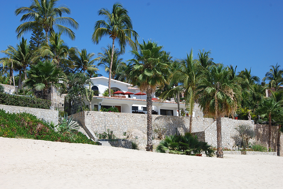 exterior view from the beach of a large spanish style house