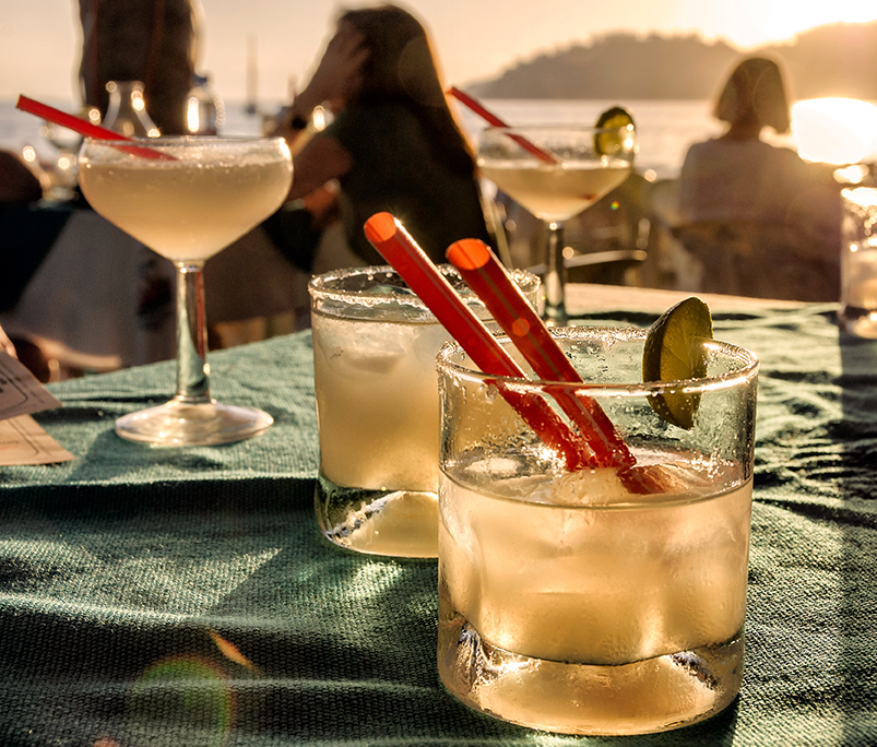 2 cocktails on a table during sunset