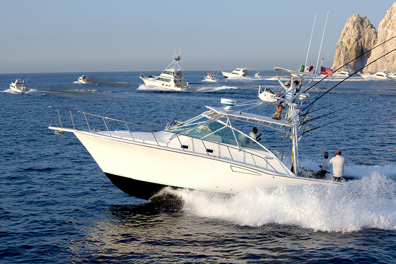 Sport fishing boat with men on the back waving